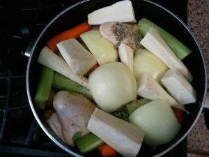 Cut up veggies and chicken in pot
